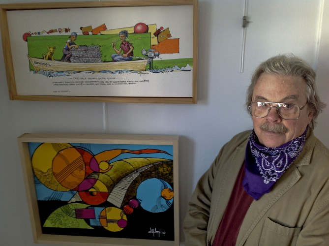 Tom Chipley, an artist at The Art Group Gallery in Mount Jackson, stands beside two of his works inside his studio. Ryan Cornell/Daily