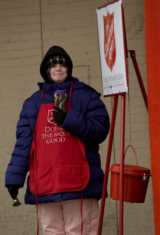 Dana Payne rings the bell for the Salvation Army outside   Kmart  in the Royal Plaza Shopping Center  in Front Royal on a cold afternoon. Payne was working a seven-hour shift manning the kettle.  Rich Cooley/Daily