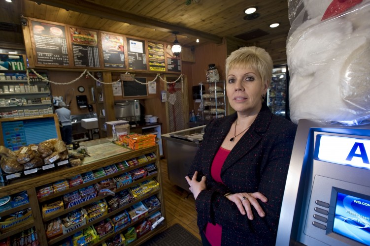 Lisa Salazar, owner of Henry's Grocery, stands inside her business  on Strasburg Road. Salazar has sought signatures inside her store against Dollar General's rezoning effort on property for a store along Strasburg Road near Homestead Drive.    Rich Cooley/Daily