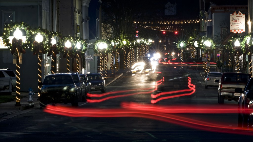 Tail lights illuminate this portion of East Main Street in Front Royal as street lamps are decked out for the Christmas season during this recent night time exposure. The Virginia is for Lovers website has listed Front Royal as one of Virginia's favorite Christmas towns.  Rich Cooley/Daily