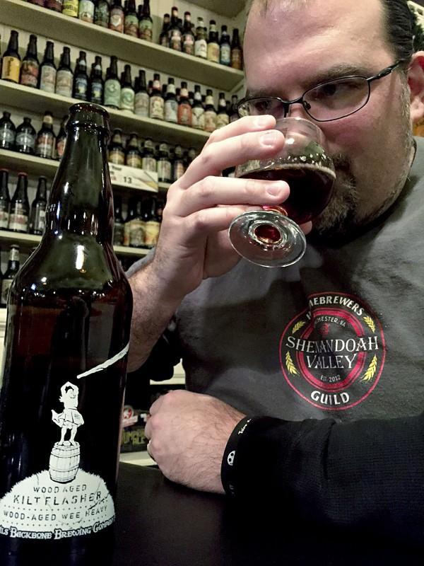 Tim Arndt drinks a barrel-aged kilt  clasher. Courtesy photo