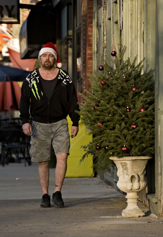 Charles Brinklow, of Woodstock, enjoys the pleasant, 60-degree weather as he strolls along South Main Street on Monday.  Rain and cooler weather are in Tuesday's forecast.   Rich Cooley/Daily