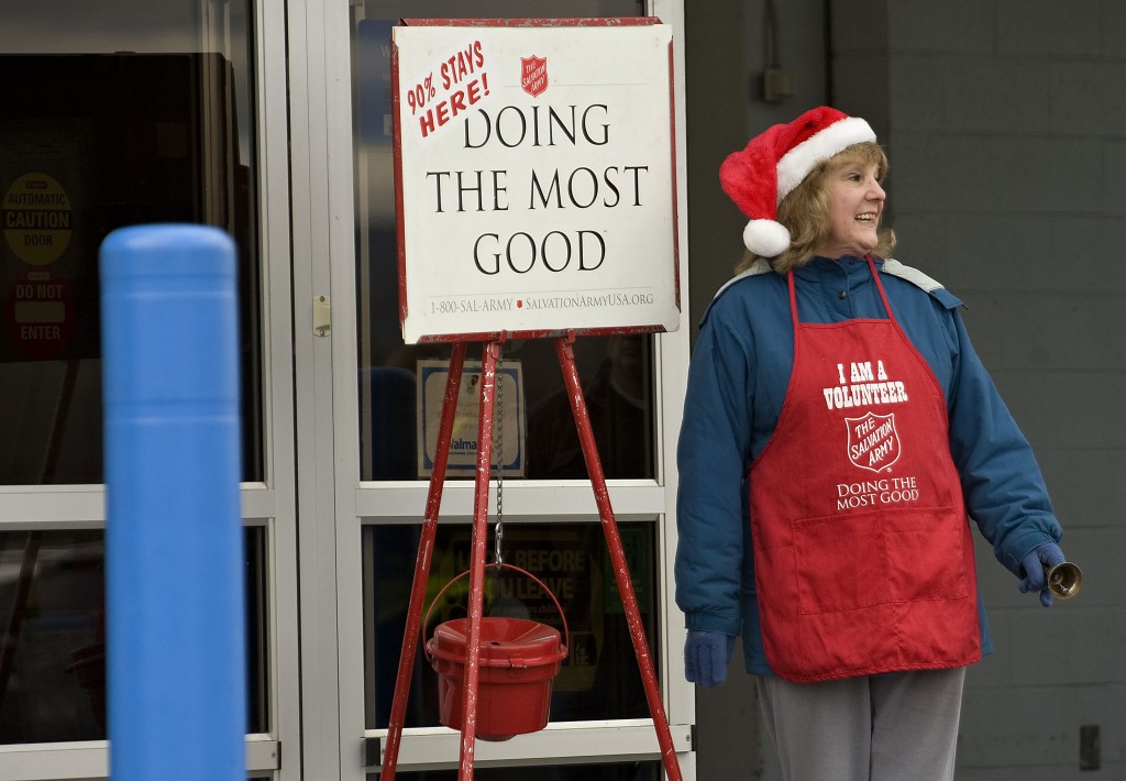 Pat Turley, a member of the Basye-Bryce Mountain Lions Club, rings the bell for the Salvation Army outside Walmart in Woodstock on a cold Friday afternoon. The Shenandoah County Chapter will be ringing until Christmas Eve. Those wanting to donate can send donations to the Salvation Army, 617 Kestrel Court,  Woodstock. Rich Cooley/Daily
