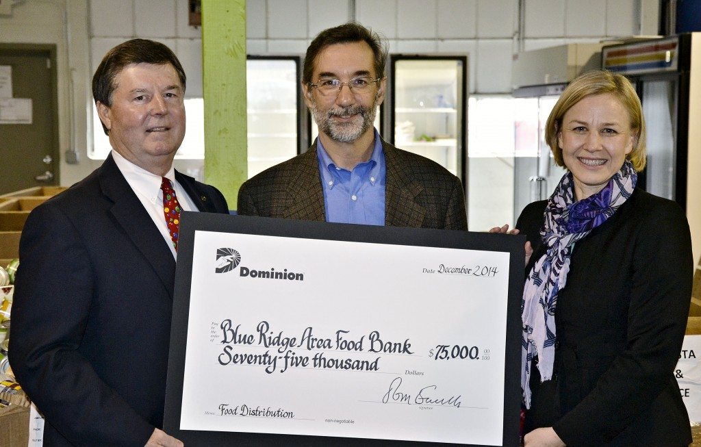 Michael McKee, center, CEO of the Blue Ridge Area Food Bank, accepts a $75,000 check from Emmett Toms, left, Dominion External Affairs manager, and Susan King, External Affairs representative, on Tuesday. The donation will provide 300,000 meals, enough to feed more than 3,000 Shenandoah Valley residents, including 35,900 served through the Lord Fairfax Area Food Bank in Winchester.  Courtesy photo