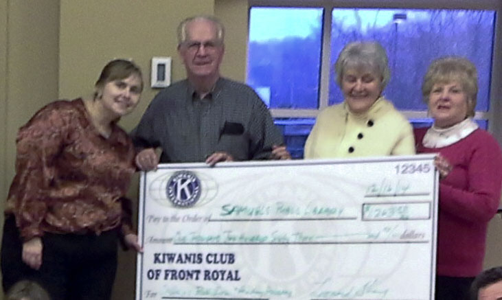The children's department of Samuels Public Library in Front Royal received a donation of $1,263 on Dec. 16 during Big Kids story time from the Front Royal Kiwanis Club. Shown from left  are Michal Ashby, youth services supervisor for the library; Tom Curry, president of the Front Royal Kiwanis; Linda Allen and Barbara Tringali.   Courtesy photo