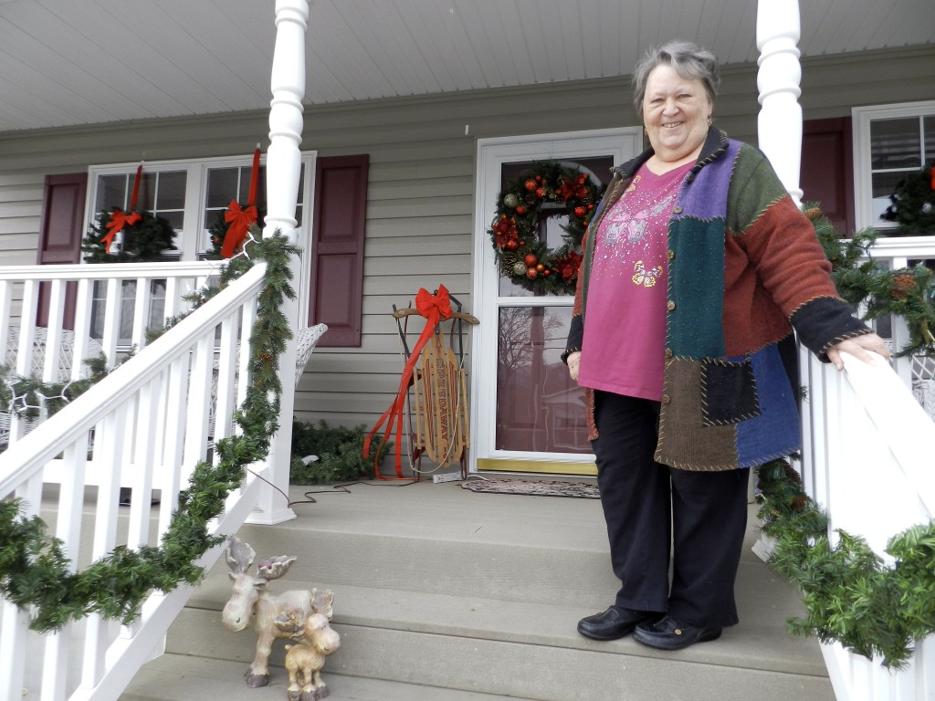 Emily Koon, of Edinburg, was awarded second place in the town's residential decorating contest. She said she returned to Edinburg in August after living in Richmond for 25 years. Ryan Cornell/Daily