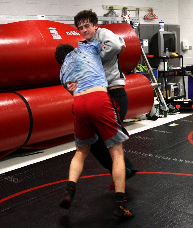 Stonewall Jackson's Kyle Cowart, right, spars during wrestling practice on Tuesday afternoon in Quicksburg.   Brad Fauber/Daily