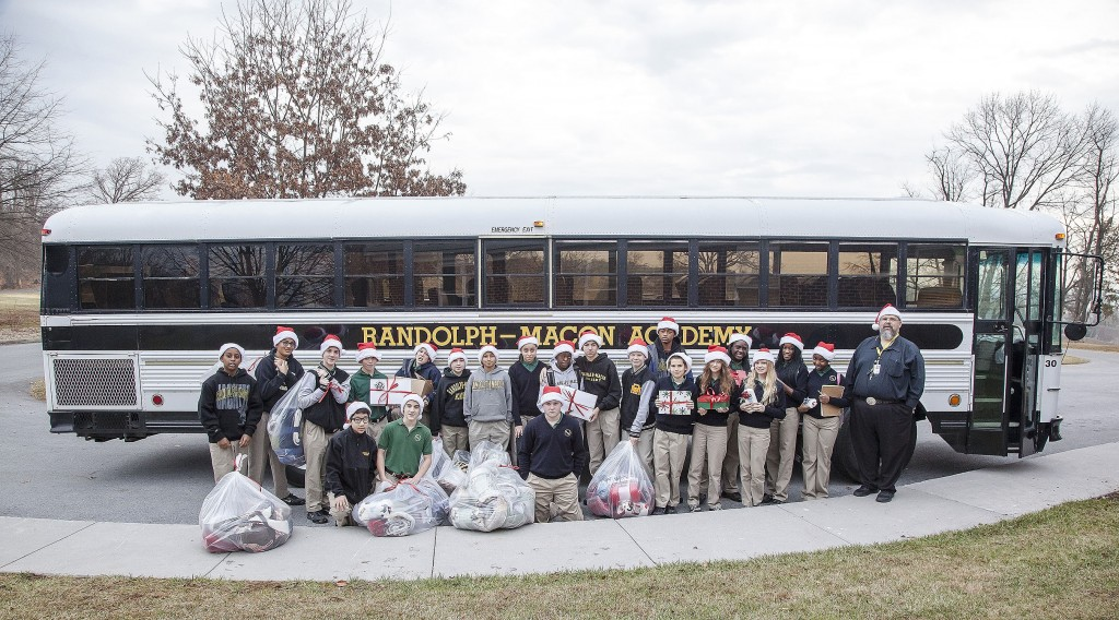 """Randolph-Macon Academy Middle School teacher Toby Allanson took what had been a small family tradition and turned it into a project for his seventh grade civics class, when he took all of his students to the VA Hospital in Martinsburg, West Virginia, to hand out gifts and sing Christmas carols. Allanson dubbed this year's event """"Operation Thank You."""" On Dec. 16, students delivered 91 blankets (the goal was 75), 21 pairs of slipper socks, 24 bottles of lotion and lots of liquid soap. They were joined by R-MA Chorus Director Michael DeMato and six of his students. Courtesy photo"""