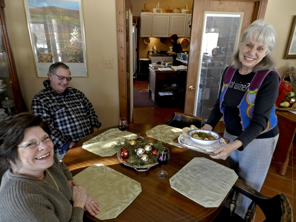 Krista Jackson-Foster, owner of North Mountain Vineyard and Winery in Maurertown, sets down a bowl of soup at the winery's Soup Saturday event last weekend. Sitting at the table are Jackson-Foster's husband, Brad, and All Things Virginia owner Vicki Ruckman. Ryan Cornell/Daily