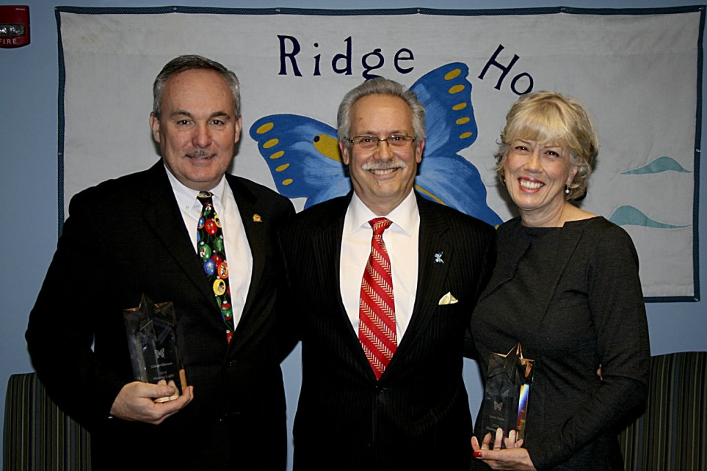 Blue Ridge Hospice Executive Director Ernie Carnevale is flanked by Wells Fargo's Lynne Sayles and Mike Wilkerson. Blue Ridge Hospice  awarded 2014 Shining Light honors to the two Wells Fargo representatives last month. Courtesy photo