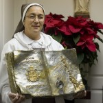 Sister Maria Jose Socials, a member of the  Pierced Hearts of Jesus and Mary, holds the first class relic of Saint John Paul II's blood that was making a final stop at Sacred Heart Catholic Church in Winchester following  Mass  Wednesday evening.  Rich Cooley/Daily