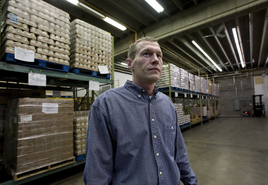 Jarrett Tomalesky, branch manager for the Lord Fairfax Food Bank, stands inside facility's 10,000-square-foot warehouse in Winchester. The regional food bank is planning to expand its distribution capabilities. Rich Cooley/Daily