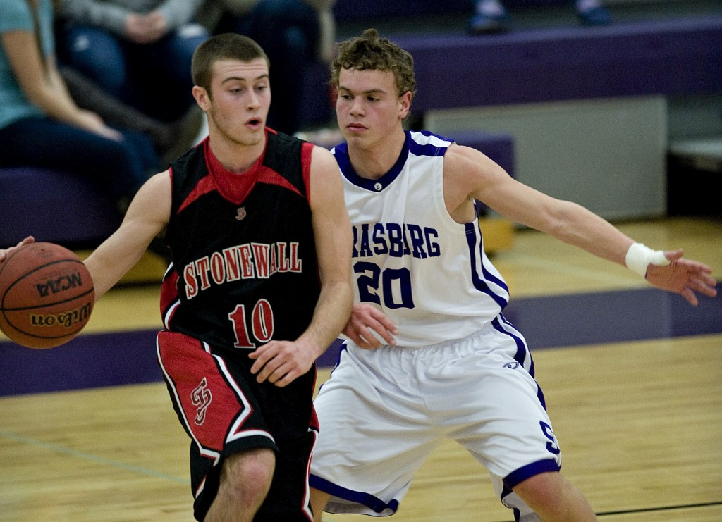 Stonewall Jackson's Nathan Miller brings the ball down the floor as Strasburg's Tyler Fincham defends during a Jan. 19 boys basketball game in Strasburg. Both teams are set to play in the Conference 35 tournament, which was scheduled to start tonight but could be pushed back due to inclement weather.   Rich Cooley/Daily file