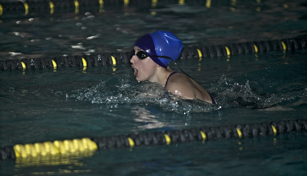 Strasburg's Cassie Cooper competes in the 200-yard freestyle during the Shenandoah County swim meet held Wednesday night at the Strasburg Recreation Center.  Rich Cooley/Daily