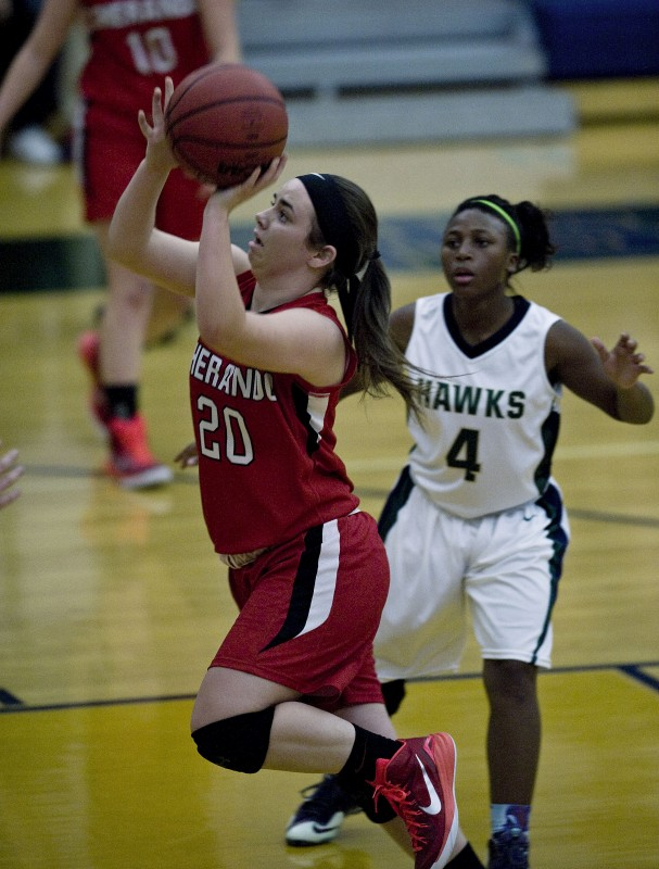 Sherando's Jess Hakel drives to the basket against Skyline on Dec. 12 in Front Royal. Hakel's versatility played a big part in Sherando's success this year. Rich Cooley/Daily file