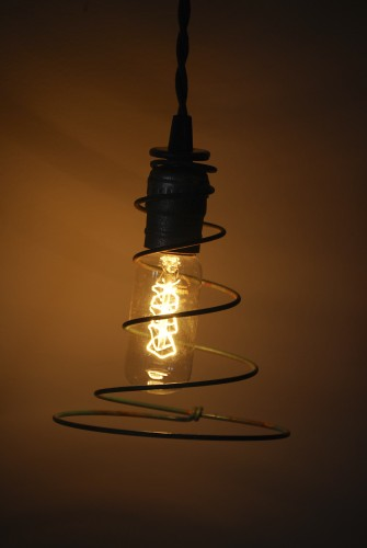 An old bedspring makes an interesting light fixture.  Photo by Bobbie Wilinski, courtesy of the Museum of the Shenandoah Valley