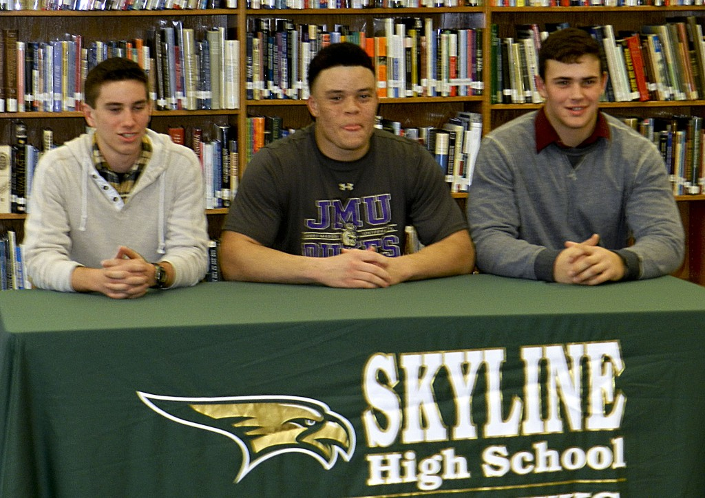 From left, Skyline's Justin Haggerty (Belmont Abbey, boys soccer), Gerren Butler (JMU, football) and Ronnie Clifton (Lenoir-Rhyne, football) signed letters of intent on Wednesday to play in college. Tommy Keeler/Daily