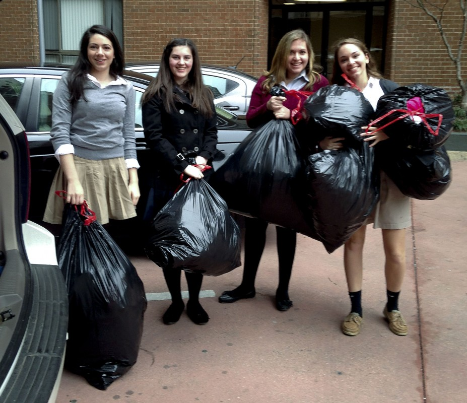 Wakefield Country Day School students, from left, Anna Clarke, Megyn Kelly, Rebecca Paulisch and Monica Marciano delivered several bags of donated outerwear to the Coalition for the Homeless in Washington, DC.  Courtesy photo