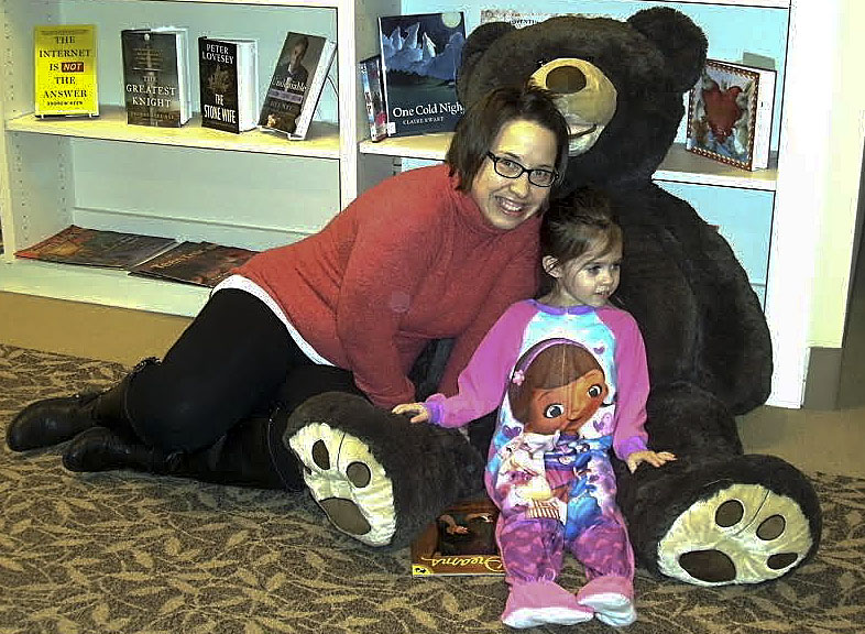 Kim and Micah Miller pose with the big bear at the pajama party held  Feb. 4, to kick off the New Market Area Library's winter reading program.  Photo by Pam Miller