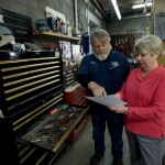 Bill and Freda Palmer work in their auto repair shop in Strasburg recently.  Palmer's Garage, which opened 35 years ago,  will close on March 31 and will be opened the next day under new ownership. Rich Cooley/Daily