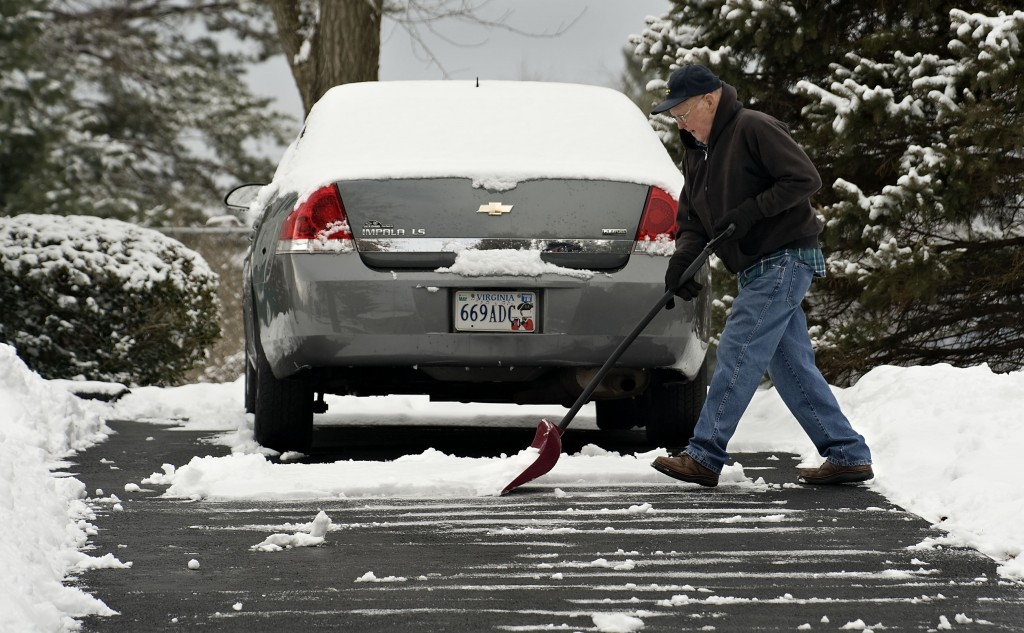 Bill Caudill, 82, clears his driveway outside his home on  West 15th Street in Front Royal on Thursday.  Rich Cooley/Daily