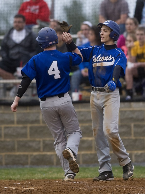 Central's  Cody Sager, right, and Samuel Cornman celebrate after scoring a pair of runs during a game against Stonewall Jackson last season. Sager is expected to have a major impact on the mound and at the plate for the Falcons this season.  Rich Cooley/Daily file