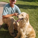 Tim Cline, owner of DogWatch of Winchester,  trains a golden retriever using the DogWatch system.