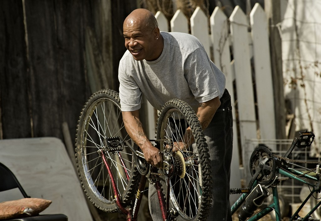Elmo Edwards, 55, of Front Royal, takes advantage of a spring-like afternoon recently to tune up his bicycle outside his Osage Street home. Friday will be partly sunny with a high of 52, but a chance of rain is in the forecast through Saturday. Sunday is expected to be mostly sunny with a high near 52.  Rich Cooley/Daily