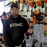 Trey Moomaw shows off one of the latest weed trimmers at Route 11 Equipment Sales, which is located at 9800 S. Congress St. in New Market. Photo by Henry Culvyhouse