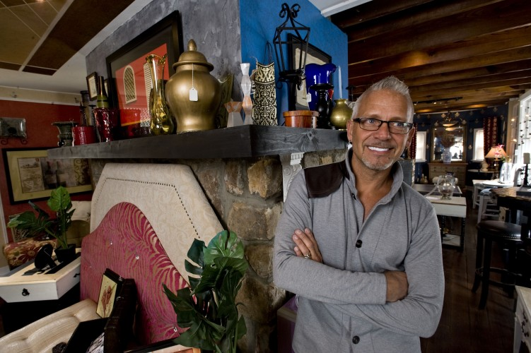 Keene Moreau stands by a wall in his design studio Le Faux Chateau at the corner of South Street and South Royal Avenue in Front Royal.  Moreau changes the design of the interior walls every three months.  Rich Cooley/Daily