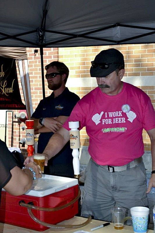Jay Byrne, from the Espresso Bar in Winchester, serves beer during the 2013 Hop Blossom in Winchester.  Courtesy photo