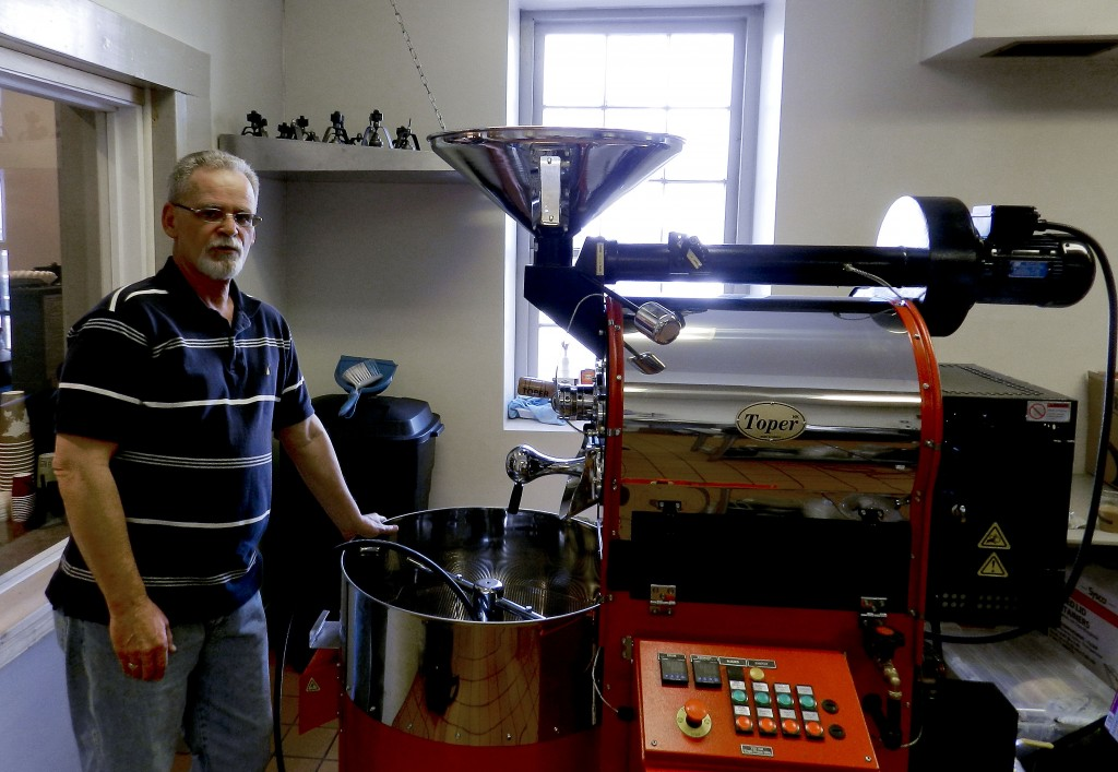 Monty Ruckman, owner of Jackson's Corner Café and Cabin Creek Roasters, stands next to his new Toper bean roaster.  Henry Culvyhouse/Daily