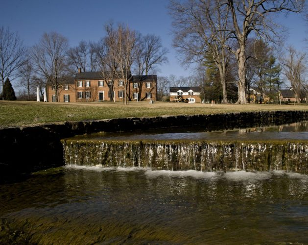Water from the town run cascades over this small waterfall outside Glen Burnie in Winchester. The original house dates back to 1794.   Rich Cooley/Daily