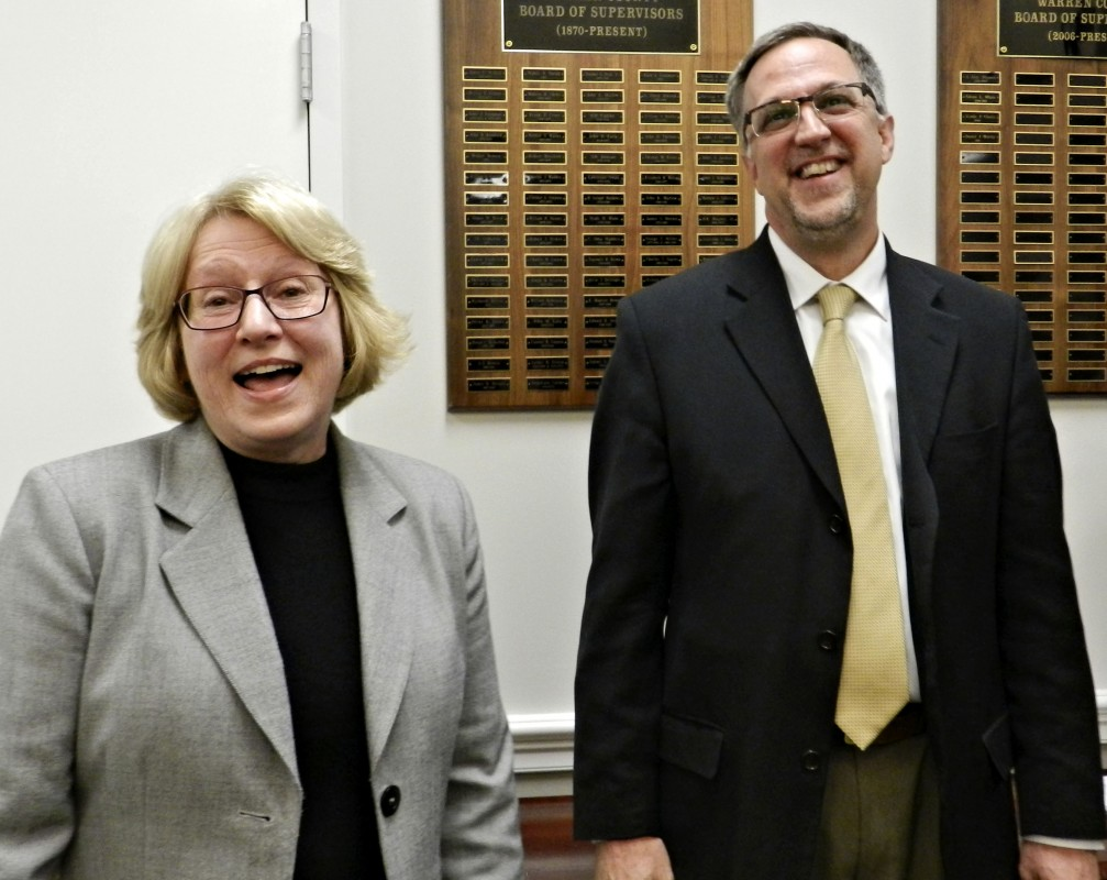Greg Drescher, right, assistant superintendent for instruction with Warren County Public Schools, laughs with Superintendent Pamela McInnis Thursday following the announcement at a special meeting that he will succeed her as superintendent, effective July 1 after she retires this spring.  Josette Keelor/Daily