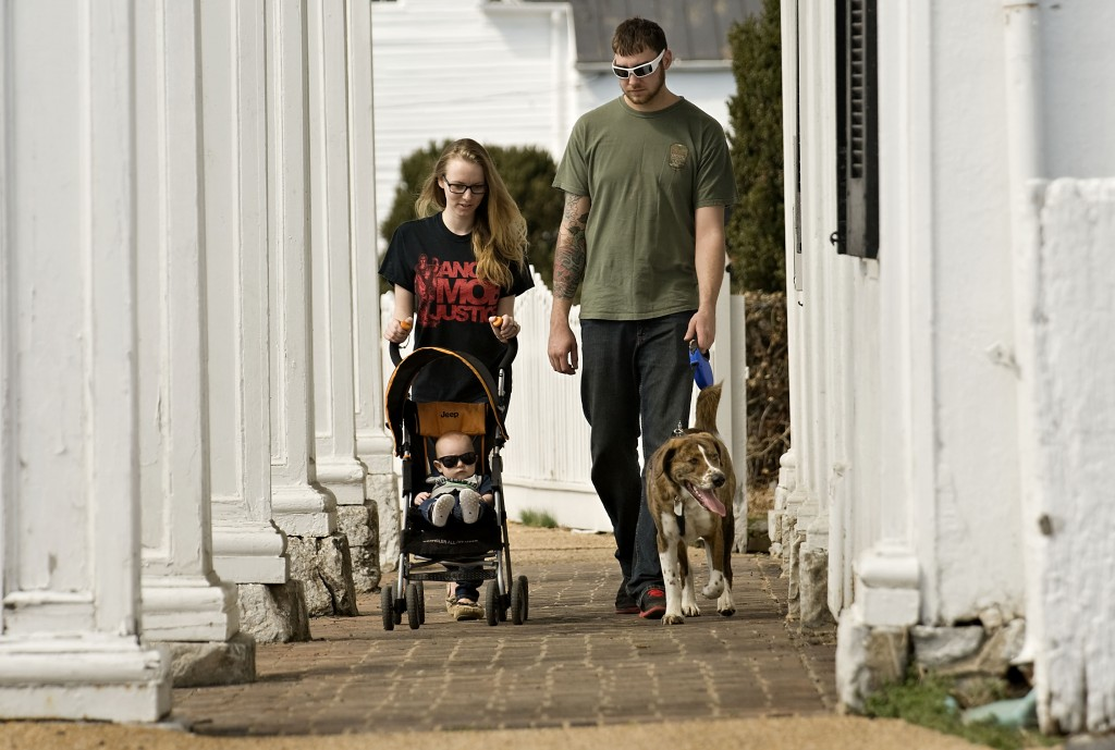 Amber and Cody Martin walk their son  Aden, 5 months, and dog Dexter on a spring day along Chester Street in Front Royal.   Rich Cooley/Daily