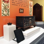 """Just opened in the Museum of the Shenandoah Valley in Winchester, """"Collect, Preserve, Interpret: Ten Years at the MSV"""" displays objects made in the Shenandoah Valley during the last three centuries. Pictured here is a jamb stove front plate made around 1773 in Frederick County and a recently conserved blanket chest made between 1800 and 1809 in Shenandoah [now Page] County by artist Johannes Spitler [1774–1837].  Photo by Rick Foster, courtesy of the MSV"""