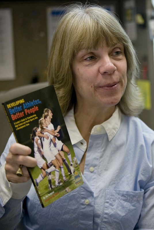 "Robin Richardson, Deputy Director of Warren County Parks and Recreation Department, holds a copy of the book ""Developing Better Athletes, Better People."" Richardson has been named a 2015 Development Zone Leadership Fellow by Positive Coaching Alliance (PCA) for using high school and youth sports to develop ""Better Athletes, Better People.""  Rich Cooley/Daily"