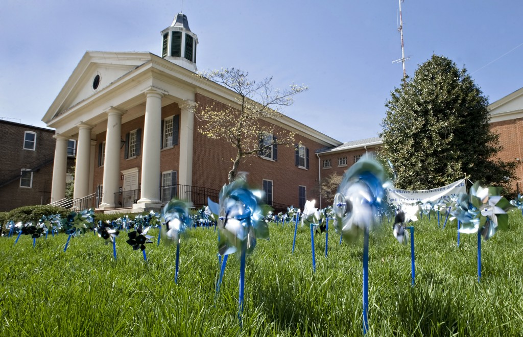 Pinwheels planted by Response Inc.  spin outside the Shenandoah County Circuit Courthouse  in Woodstock. Rich Cooley/Daily