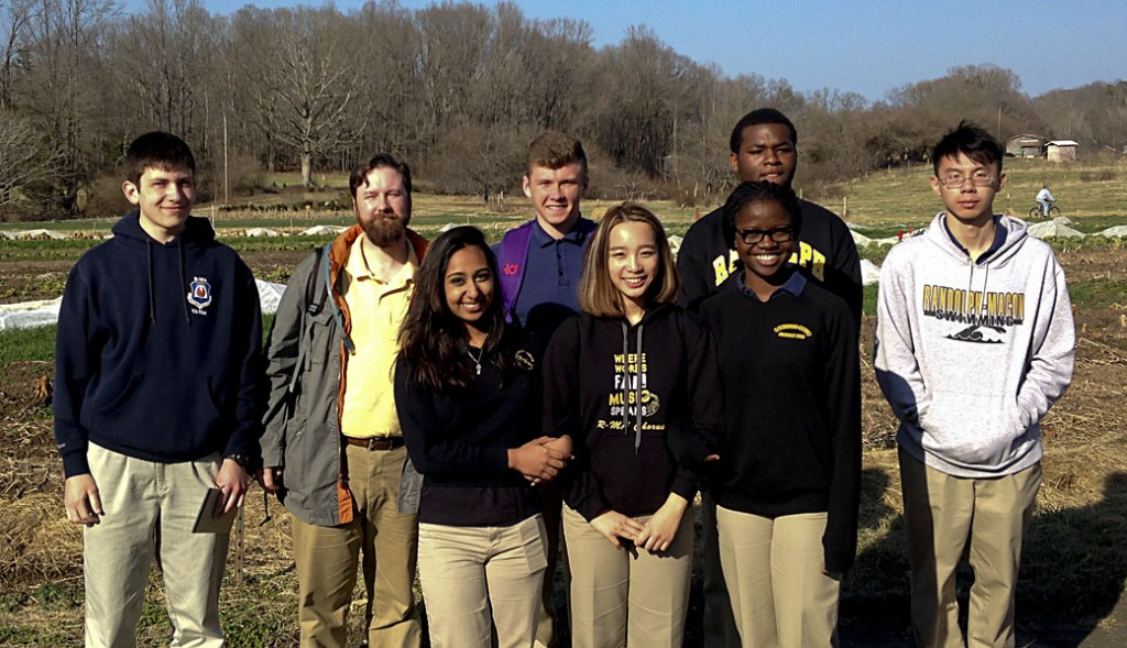 """Randolph-Macon Academy students from the Utopian/Dystopian Literature class, along with teachers Brandon Sloan and Bryan McCabe, went on a March 21 field trip to Twin Oaks, a small independent community based on the ideas in B.F. Skinner's 1948 novel """"Walden Two."""" Shown here on their field trip are, back row from left,  Gordon Anderson, Brandon Sloan, Tyler Vaughan, Peniel Okonkwo, and Cheng Qian, and in the front row, from left, Jessica Neupane, Chloe Pham, and Motunrayo Bamgbose-Martins, a guest of one of the students.  Courtesy photo"""
