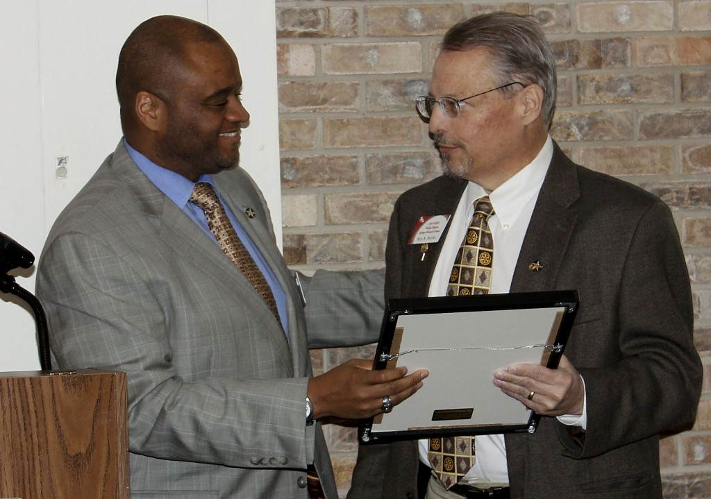 Juandiego Wade, current Virginia School Boards Association  president and chair of the association's  Board of Directors, presents a resolution honoring Roy Boyles, a former Warren County School Board member.  Courtesy Photo