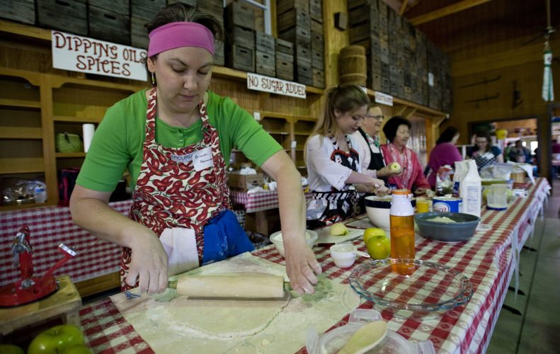 Brandi Hammond, of Stephens City, rolls out her pie dough during  the Apple Pie Baking Contest held at Marker -Miller Orchards Farm Market and Bakery in Winchester on Thursday morning. There were 21 contestants in the adult and youth divisions competing. Jessica Story, of Stephens City,  won the adult division and Hannah Keri, 13, of Delaplane, won the youth divison. The contest was sponsored by BestCare Home Care. Rich Cooley/Daily