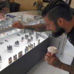 LiBeau Omens Vape Co. and Artisan Trail Tattoo shop co-owner Beau Morgan reviews his e-liquid selection.  Rachel Mahoney/Daily