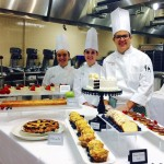 Cody Fitchett with his team and the desserts they made for the semester showcase. Courtesy photo