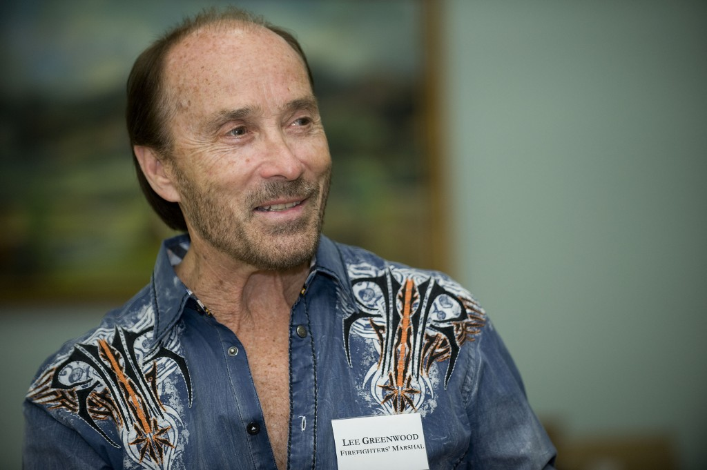 Country music singer Lee Greenwood, the Firefighters Marshal for this year's Shenandoah Apple Blossom Festival, speaks during a media interview Friday. Rich Cooley/Daily