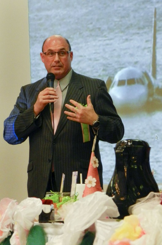 Motivational speaker Dave Sanderson speaks at Friday's Ladies' Horticultural Luncheon in Winchester about his experience surviving an emergency plan landing on the Hudson River between New York City and New Jersey on Jan. 15, 2009.