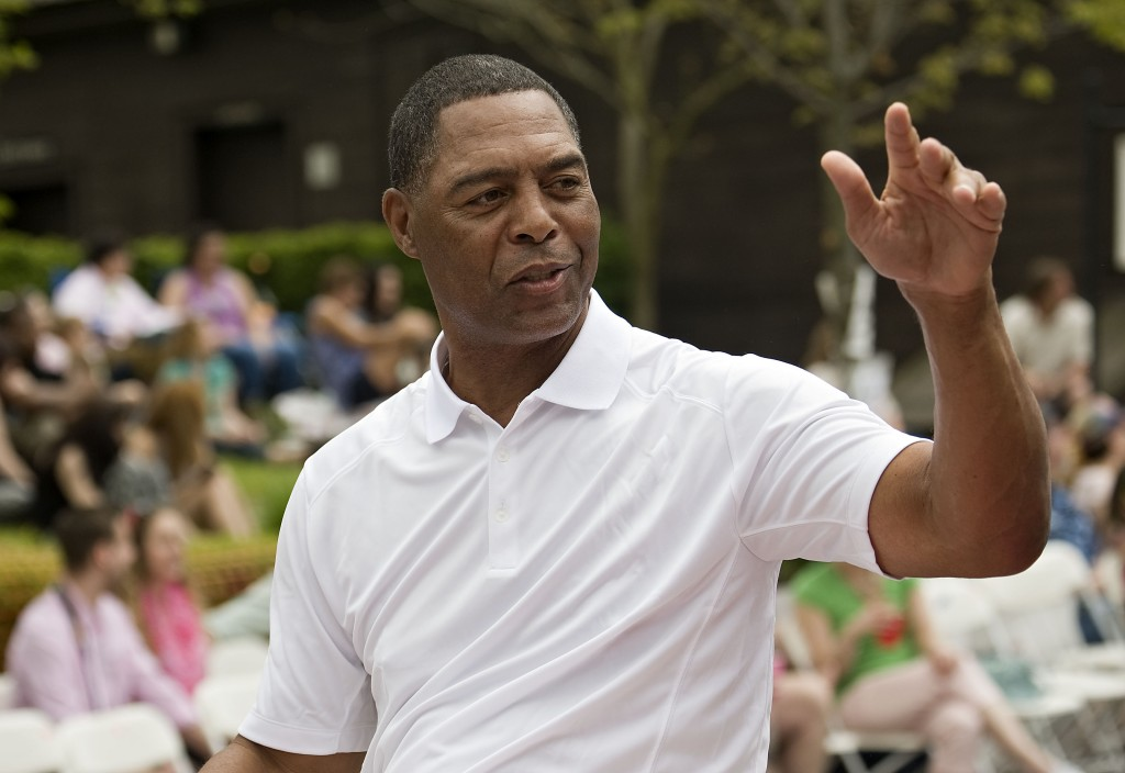 Apple Blossom Sports Marshal Marcus Allen waves to fans along Braddock Street during the parade. Rich Cooley/Daily
