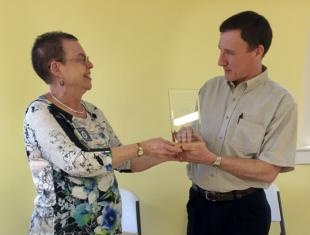 Jeannette Dovel, president of the Strasburg Powhatan Ruritan Club, presents Mark Baisle, of the Carmeuse Group, with the Powhatan Ruritan Business of the Year Award for 2015 recently for their assistance in fund-raising efforts. Carmeuse is a producer of lime and limestone products in Strasburg. Courtesy photo