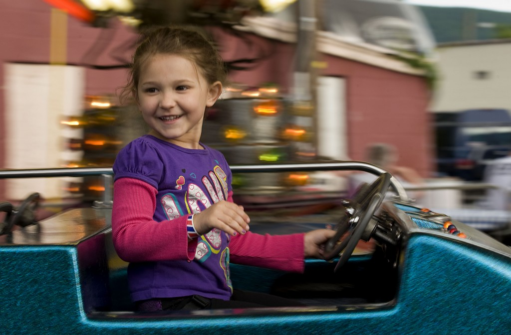 Hayleigh Ebersole-Coleman, 5, of Strasburg, rides the combo ride at the carnival this week. The carnival is open during Strasburg's Mayfest celebration.   Rich Cooley/Daily