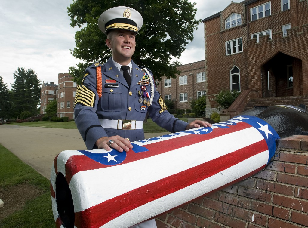 Cadet Lt. Col. Jeffrey Brown, 18, stands outside the painted cannon that is a tradition of graduates to paint during graduation week at  Massanutten Military Academy in Woodstock.  Brown is the top commanding graduate in the Class of 2015, which will produce 24 seniors during commencement ceremonies for Saturday.    Rich Cooley/Daily