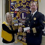 Bobbie Jo Poling, president of the Strasburg Lions Club, presents the club's annual $300  donation to Strasburg Fire Chief Jeff Wharton of the Strasburg Fire Department. The Lions Club, which was chartered in 1942, has supported community activites for the past 73 years. The donation will be used for the funding of a new fire truck. Courtesy photo